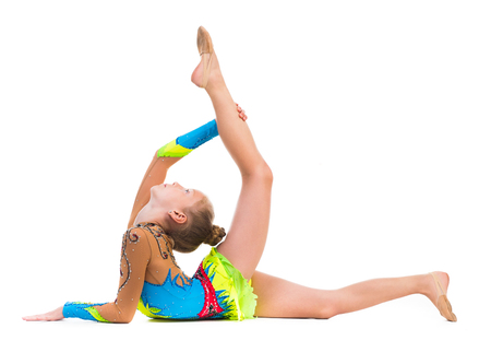 Photo pour tittle gymnast doing stretching exercise isolated on white background - image libre de droit