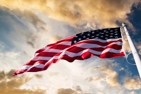 Photo pour american flag waving  blue sky - image libre de droit