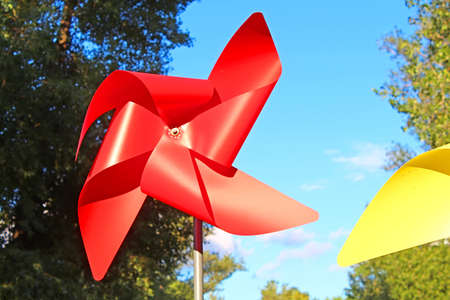 Photo for Large red and yellow children pinwheels in the Natalka park, Kyiv, Ukraine - Royalty Free Image
