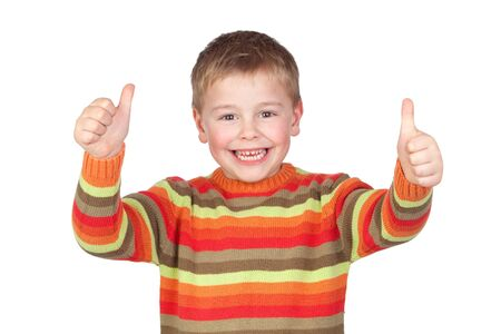 Adorable child with thumbs up isolated on white background
