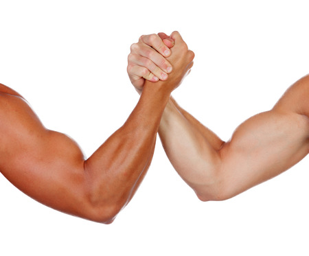 Photo for Two powerful men arm wrestling isolated on a white background - Royalty Free Image