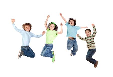 Photo pour Four joyful children jumping isolated on a white background - image libre de droit