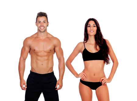 Foto de Young couple showing their perfect bodies isolated on a white background - Imagen libre de derechos