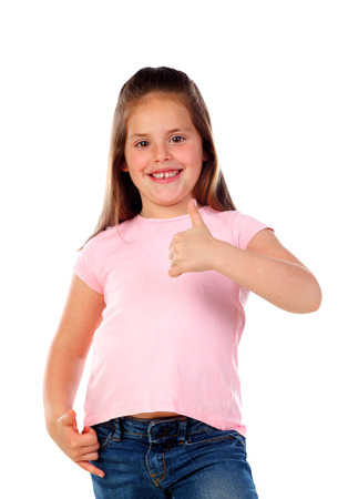 Photo for Friendly child saying Ok with her thumbs isolated on a white background - Royalty Free Image