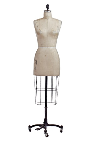 Photo pour Antique dressmakers form with beige linen fabric cover and black wrought iron stand on castors. Front view, vertical, isolated on white, copy space. - image libre de droit
