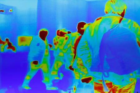 Foto de Infrared thermal image of a group of passengers at security control. - Imagen libre de derechos