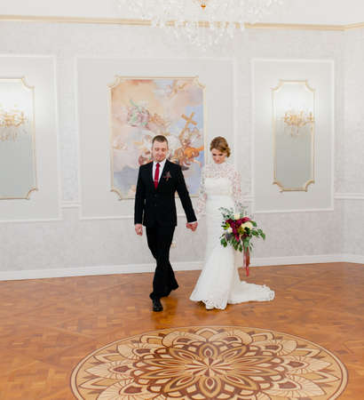 Photo for Groom and bride portraits in the beautiful classic interior - Royalty Free Image