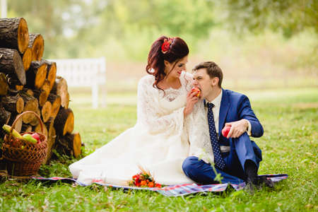 Photo for Couple newlyweds in a autumn park - Royalty Free Image