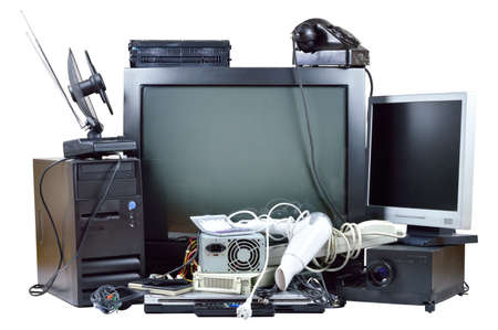 Foto de Old and used electric home waste  Obsolete pc computer, telephone, CRT monitor, DVD  - Imagen libre de derechos
