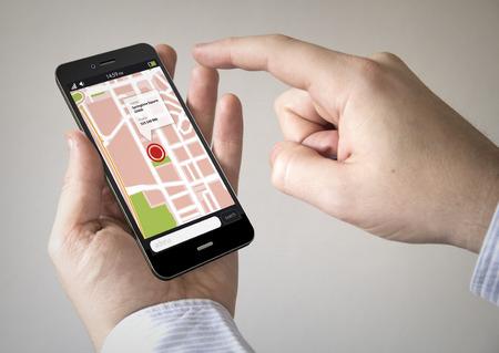 Foto de Navigation via Smart phoneconcept: Close up of man using Black Smartphone with a GPS map - Imagen libre de derechos