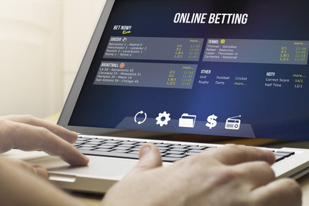 Foto de addiction concept: using the computer to online betting - Imagen libre de derechos