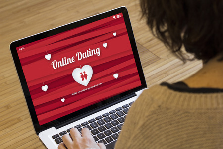 Photo for dating online concept: online dating website on a laptop screen. Screen graphics are made up. - Royalty Free Image