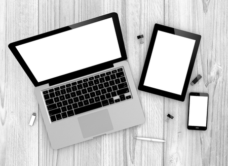Digital generated devices over a wooden table. laptop, tablet and white smartphone.