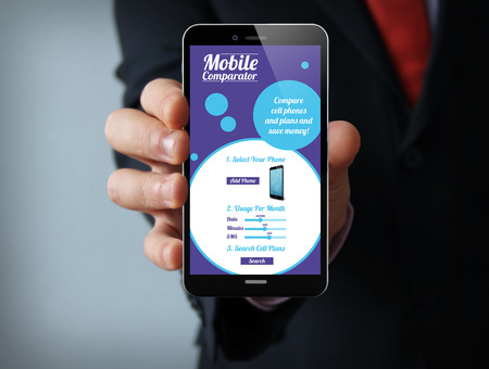 Photo pour new technologies business concept: businessman hand holding a 3d generated touch phone with online mobile comparator on the screen. Screen graphics are made up. - image libre de droit