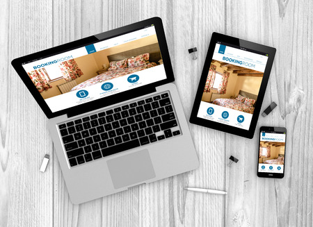 Foto de Digital generated devices over a wooden table. laptop, tablet and white smartphone with made up responsive booking website . - Imagen libre de derechos