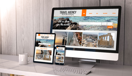 Foto de Digital generated devices on desktop, responsive blank mock-up with travel agency website  on screen. All screen graphics are made up. - Imagen libre de derechos