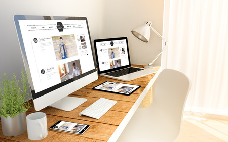 Photo pour Digital generated devices over a wooden table with blog responsive concept. All screen graphics are made up. - image libre de droit
