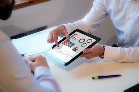 Foto de businessman showing financial strategy on a tablet in a business meeting. All screen graphics are made up. - Imagen libre de derechos