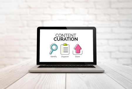 Photo for digitally generated laptop on a wooden table with Content curation graphic. Screen graphics are made up. - Royalty Free Image