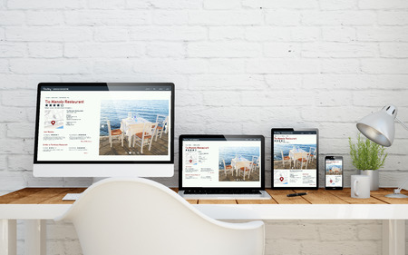 Foto de multidevice desktop with fresh design website on screens. 3d rendering. - Imagen libre de derechos