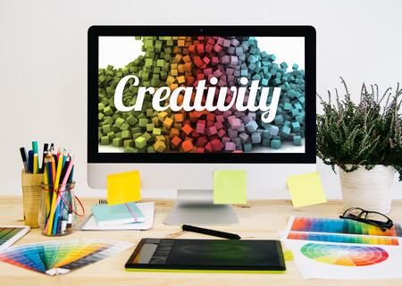 Foto de Stationery desktop with design stuff, computer and graphic tablet. creativity on screen. - Imagen libre de derechos