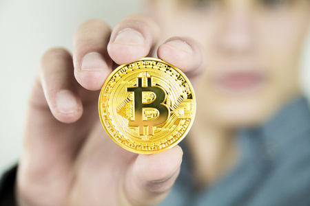 Photo for Young businessman showing bitcoin - Royalty Free Image