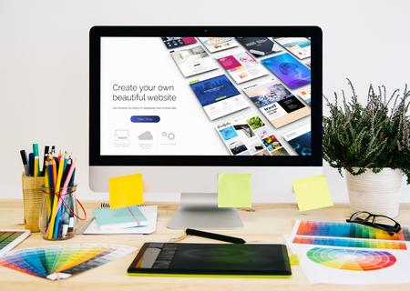 Foto de  Stationery desktop with design stuff, computer and graphic tablet. website builder design. - Imagen libre de derechos