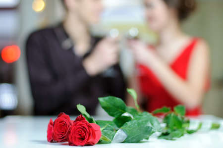 Photo pour Young happy couple romantic date drink glass of red wine at restaurant, celebrating valentine day - image libre de droit