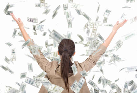 Foto de Young business woman and money banknotes flying in air on the white background. - Imagen libre de derechos