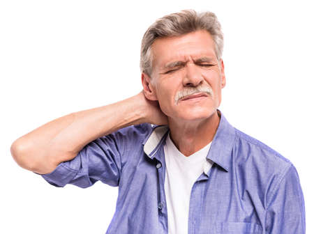 Photo pour Senior man is suffering from neck pain. - image libre de droit