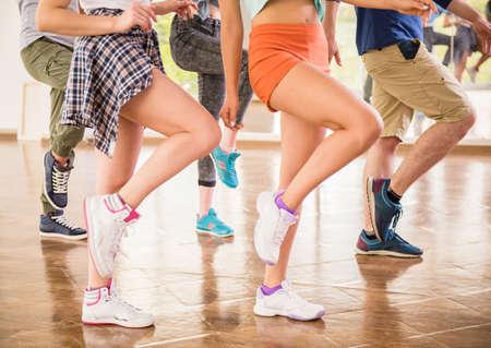 Foto de Young dancing people in gym during exercise dancer workout training with happy fresh energy. - Imagen libre de derechos