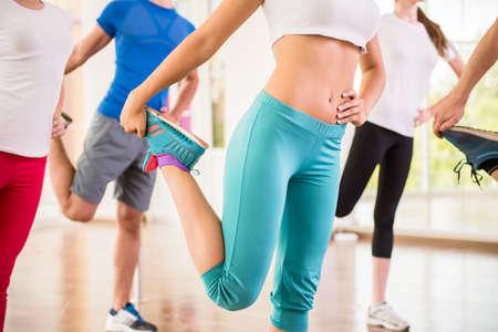Foto de Fitness dance studio class. Group of people are exercising in dance studio. - Imagen libre de derechos