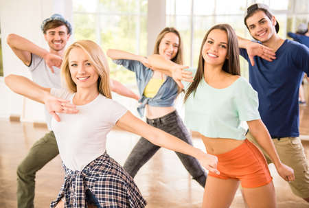 Foto de Young dancing people in gym during exercise dancer workout training with happy fresh energy. - Imagen libre de derechos