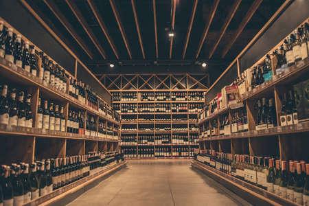 Foto de At the supermarket. Rows of wine waiting for customers - Imagen libre de derechos