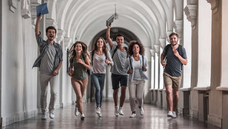 Photo for Beautiful young students are looking at camera and smiling while running through the university hall - Royalty Free Image