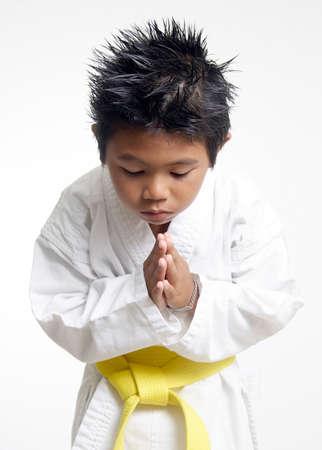 Karate boy bowing
