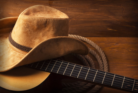 Photo pour American Country music background with guitar and cowboy hat - image libre de droit