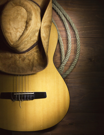 Photo pour American Country music with guitar and cowboy hat on wood background - image libre de droit