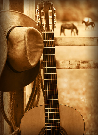 Photo pour American country music background with cowboy hat and guitar - image libre de droit