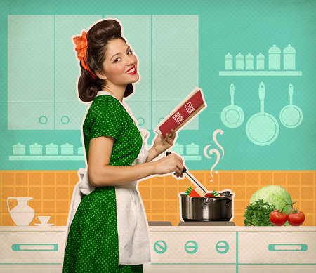 Photo for Retro smiling woman cooking and reading recipe book in her kitchen room on old paper - Royalty Free Image