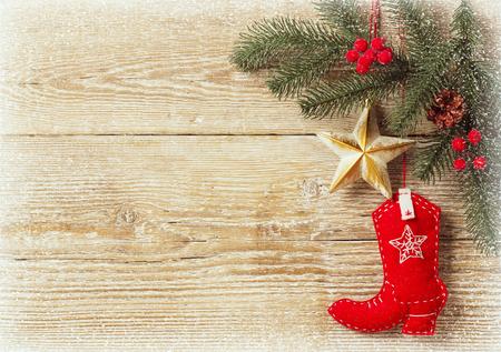 Foto de christmas background with cowboy shoe decoration toys.Wood texture for text - Imagen libre de derechos