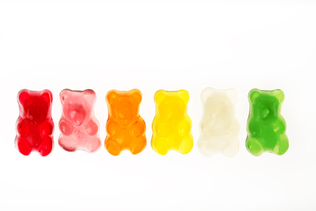Photo for Childhood and jelly bears candies isolated on white background - Royalty Free Image