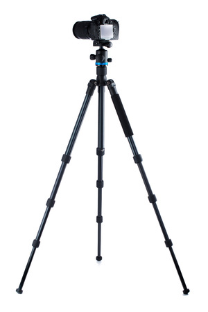 Photo for Photo camera on tripod isolated over white background - Royalty Free Image