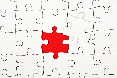 Photo pour Missing piece in a puzzle on red background - image libre de droit