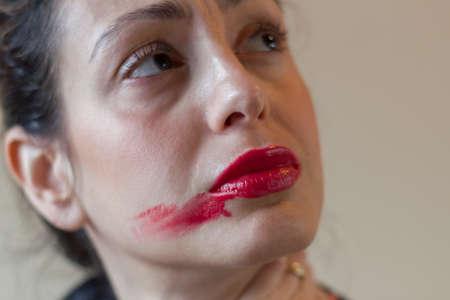 Photo pour Smudged lipstick and worried look. - image libre de droit