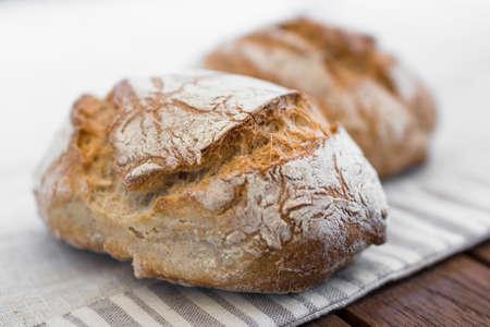 Foto de Extreme clos-up of rustic Italian bread, isolated on background out of focus. - Imagen libre de derechos