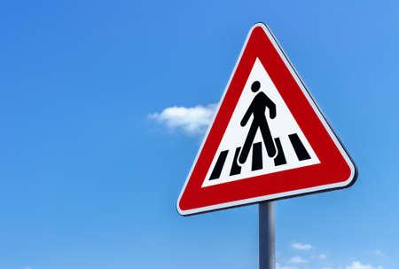 Photo pour Pedestrian crossing sign against blue sky background - image libre de droit