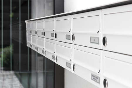 Foto de Mailboxes and lock in rows at entrance. Shallow DOF. - Imagen libre de derechos
