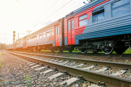 Foto per Electric train leaving in the summer time - Immagine Royalty Free