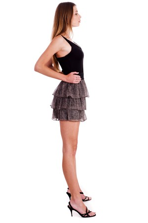 Full length of a beautiful blonde girl over white background, side view